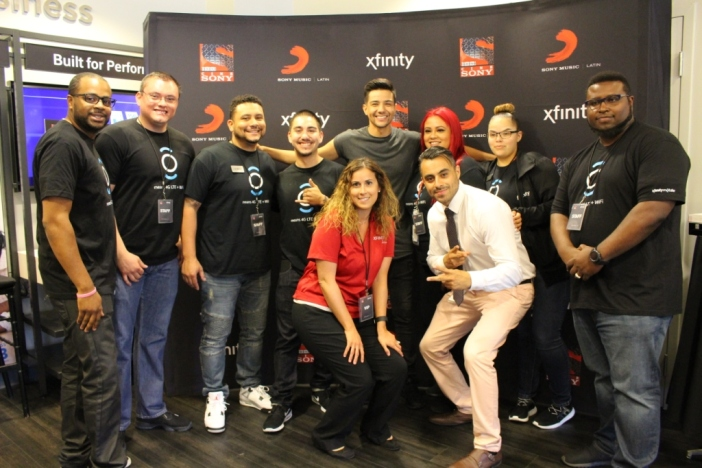 Luis Coronel with employees of the Xfinity Store in San Jose